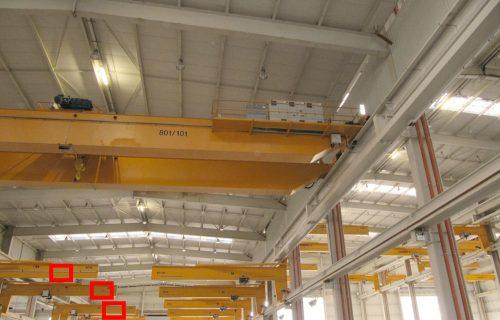 Rails électriques pour l'alimentation en puissance et contrôle de palans sur grues vélocipédiques.