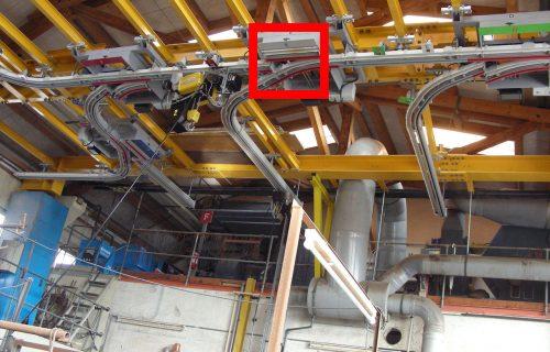 Rails électriques pour l'alimentation de palans avec courbes et aiguillages.