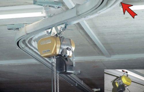 Rails électriques pour l'alimentation d'un palan avec courbes et contre courbes.